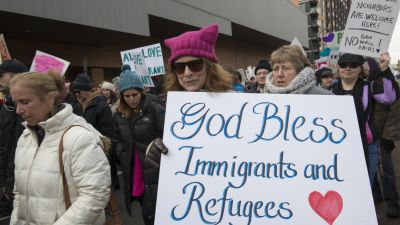 Around 2000 people gathered in downtown Minneapolis to rally in support of immigrants and refugees on Feb. 11, 2017. (Photo by Fibonacci Blue | Flickr CC 2.0)