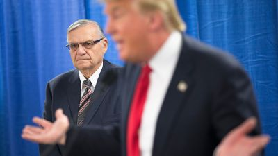 Sheriff Joe Arpaio of Maricopa County, Arizona, listens as Republican presidential candidate Donald Trump speaks to the press prior to a rally on Jan. 26, 2016, in Marshalltown, Iowa. (Photo by Scott Olson/Getty Images)