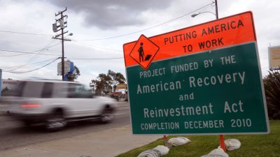 A construction sign announces a planned highway project financed by the American Recovery and Reinvestment Act in Lawndale, a suburb of Los Angeles. (Photo by Axel Koester/Corbis via Getty Images)