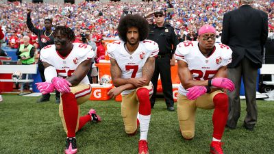 Eli Harold (#58), Colin Kaepernick (#7) and Eric Reid (#35) of the San Francisco 49ers kneel in protest on the sidelines during the national anthem prior to the game against the Buffalo Bills at New Era Field on Oct. 16, 2016. (Photo by Michael Zagaris/San Francisco 49ers/Getty Images)