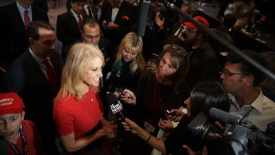 Kellyanne Conway (L), campaign manager for Republican presidential nominee Donald Trump, talks with supporters and reporters following an Election Night invitation-only party at the New York Hilton Midtown in the early morning hours on November 9, 2016 in New York City. (Photo by Chip Somodevilla/Getty Images)