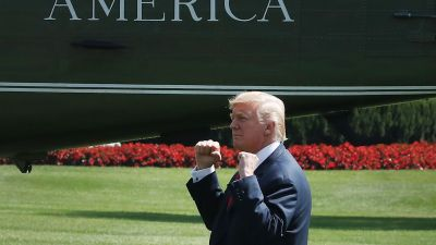 President Donald Trump gestures to a crowd gathered to watch him depart on Marine One from the White House on Aug. 4, 2017 in Washington, DC. President Trump is traveling to Bedminster, New Jersey for his summer break. (Photo by Mark Wilson/Getty Images)
