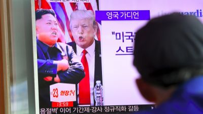 "A man watches a television news program showing President Donald Trump and North Korean leader Kim Jong-Un at a railway station in Seoul on Aug. 9, 2017. Trump issued an apocalyptic warning to North Korea on Aug. 8, saying it faces ""fire and fury"" over its missile program, after US media reported Pyongyang has successfully miniaturized a nuclear warhead. (Photo by Jung Yeon-Je/AFP/Getty Images)"
