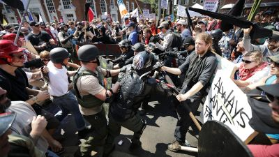 """Protesters clash in Emancipation Park at the """"Unite the Right"""" rally on Aug. 12, 2017, in Charlottesville, Virginia. (Photo by Chip Somodevilla/Getty Images)"""