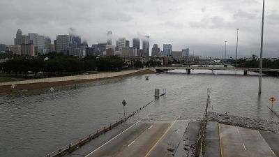 The downtown Houston skyline and flooded Highway 288 on Aug. 27, 2017 as the city battles with tropical storm Harvey and resulting floods. (Photo by Thomas B. Shea/AFP/Getty Images)