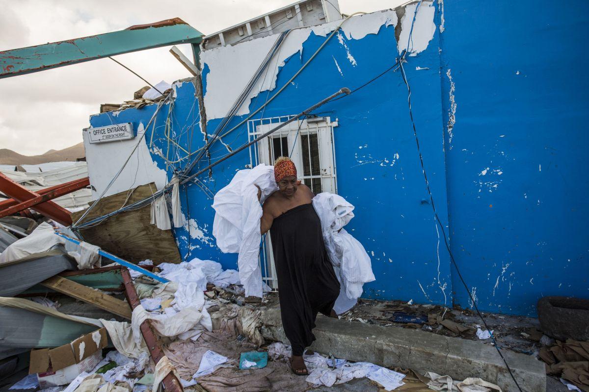 "Picture taken in St Maarten between 10 and 14 September by Netherlands Red Cross (NLRC) photographer Arie Kievit soon after Hurricane Irma damaged or destroyed more than 90 per cent of the territory's homes and buildings as it crossed near peak intensity. (Photo by <a href=""https://www.flickr.com/photos/climatecentre/36531181963/in/photolist-XE8RET-XyS67W-XEkLV8-YyfTd5-YhQoN6-XyLVfk-YxXUVb-Yzxj6U-YHxrzM-YwDViM-YUQY6X-YvTHyJ-YwZeoB-YPyRtk-XhYTKu-YFp1BV-XhZVmx-YD618C-YeJv7s-XC1TN7-XbKtHU-YdqM5c-YPyRwB-YPySFR-Ymq3a6-YrBWhk-YPySKZ-YyfTn3-XEkPbR-XB68fV-YdmAyW-Yy9f4k-XrsNzA-YjDMVi-YNLetr-YLZhqz-YivqQd-XcPJxQ-XyY34Q-YE62Ex-XB68oa-YzGu7N-YBbsES-Yss4xb-XB67Yn-YGknKx-XpYs2d-Y7vC8j-Ypt6xq-YuXoQP"" target=""_blank"">Climate Centre</a>/ flickr <a href=""https://creativecommons.org/licenses/by-sa/2.0/"" target=""_blank"">CC 2.0</a>)"