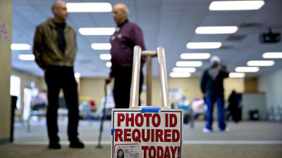 """More than 1 out of 10 nonvoters (11.2 percent) said they lacked acceptable voter ID and cited the law as a reason why they didn't vote; 6.4 percent of respondents said the voter-ID law was the """"main reason"""" they didn't vote. (Photo by Daniel Acker/Bloomberg via Getty Images)"""