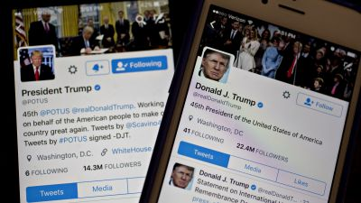 The Twitter accounts of President Donald Trump, @POTUS and @realDoanldTrump, are seen on an Apple Inc. iPhone arranged for a photograph on Friday, Jan. 27, 2017. (Photo by Andrew Harrer/Bloomberg via Getty Images)