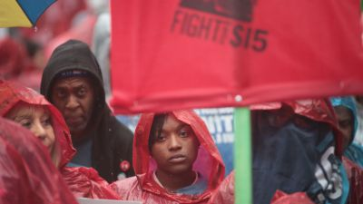 Demonstrators fighting for a $15-per-hour minimum wage march through downtown during rush hour on May 23, 2017 in Chicago. The march was held to coincide with McDonald's shareholders meeting in nearby Oak Brook. (Photo by Scott Olson/Getty Images)