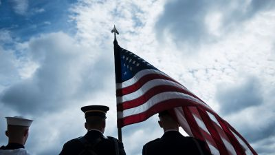 Members of a US color guard wait to greet Britain's secretary of defense, Michael Fallon, at the Pentagon on July 7, 2017 in Washington, DC. (Photo by Brendan Smialowski/AFP/Getty Images)