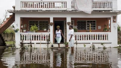Residents wade through flood waters at their home days after Hurricane Maria made landfall, on Sept. 22, 2017 in Loiza, Puerto Rico. Many on the island have lost power, running water and cell phone service after Hurricane Maria, a category 4 hurricane, passed through. (Photo by Alex Wroblewski/Getty Images)