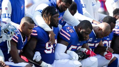 Buffalo Bills players kneel during the national anthem before an NFL game against the Denver Broncos on Sept. 24, 2017 at New Era Field in Orchard Park, New York. (Photo by Brett Carlsen/Getty Images)