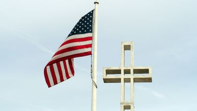Cross and Flag. (Photo by concep007/ flickr CC 2.0)