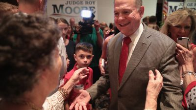 Roy Moore, Republican candidate for the US Senate in Alabama, greets supporters at an election-night rally after declaring victory on Sept. 26, 2017 in Montgomery, Alabama. Moore will now face Democratic candidate Doug Jones in the general election in December. (Photo by Scott Olson/Getty Images)