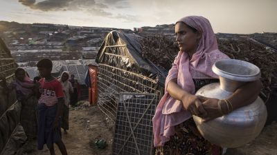 A Rohingya woman heads to get clean water from a well in the sprawling refugee camp at Palongkhali, Cox's Bazar, Bangladesh on Oct. 5, 2017. Sexual violence is committed at particularly high rates in crisis settings like war zones, refugee camps and disaster zones. (Photo by Paula Bronstein/Getty Images)