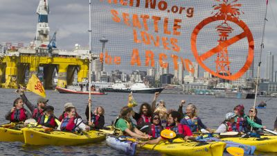 Environmental activists in kayaks protest the arrival of the Polar Pioneer, an oil drilling rig owned by Shell Oil, in Seattle. The rig is part of a fleet that will lead a controversial oil-exploration effort off Alaska's North Slope. (Photo by Backbone Campaign/Karen Ducey/Getty Images)/ flickr CC 2.0)