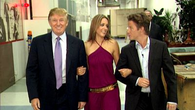 In this 2005 frame from video, Donald Trump prepares for an appearance on Days of Our Lives with actress Arianne Zucker (center). He is accompanied to the set by Access Hollywood host Billy Bush. (Obtained by The Washington Post via Getty Images)