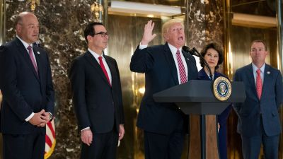 President Donald Trump delivers remarks following a meeting on infrastructure at Trump Tower on Aug. 15, 2017 in New York City. Standing alongside him (left to right): Director of the National Economic Council Gary Cohn, Treasury Secretary Steve Mnuchin, Transportation Secretary Elaine Chao and Director of the Office of Management and Budget Mick Mulvaney. (Photo by Drew Angerer/Getty Images)