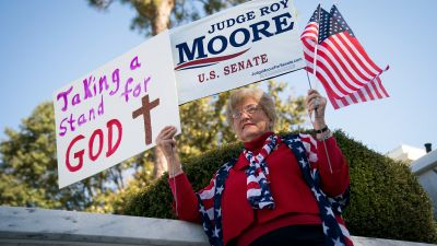 """Patricia Riley Jones attends a """"Women For Moore"""" rally in support of Judge Roy Moore, the Republican candidate for U.S. Senate, in front of the Alabama State Capitol, November 17, 2017 in Montgomery, Alabama. Kayla Moore told the crowd of supporters that her husband will not bow out of the Senate race. (Drew Angerer/Getty Images)"""
