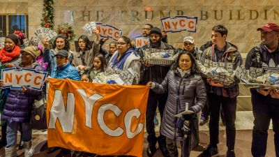 In time for Thanksgiving, members of New York Communities for Change, Strong Economy for All and other progressive advocacy groups delivered turkeys stuffed with cash to the 40 Wall Street Trump Building on Nov. 22, 2017, to highlight how Trump's tax plan will take massive sums of money from working people to benefit the richest Americans. (Photo by Erik McGregor/Pacific Press/LightRocket via Getty Images)