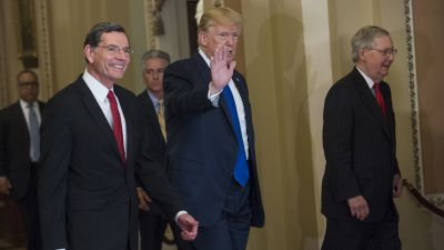 President Donald Trump arrives with Sen. John Barrasso (R-WY) and Senate Majority Leader Mitch McConnell (R-KY) for the Republican Senate Policy luncheon in the Capitol to discuss the tax reform bill on Nov. 28, 2017. (Photo By Tom Williams/CQ Roll Call)