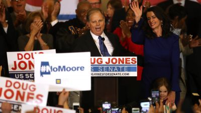 Democratic US Sen.-elect Doug Jones and his wife, Louise Jones, greet supporters during his election night gathering the Sheraton Hotel on Dec. 12, 2017 in Birmingham, Alabama. (Photo by Justin Sullivan/Getty Images)