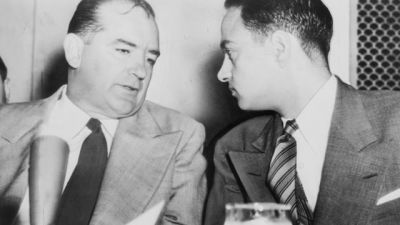 Sen. Joseph McCarthy chats with his attorney Roy Cohn during Senate Subcommittee hearings on the McCarthy-Army dispute in 1954 (Credit: Library of Congress Prints and Photographs Division. New York World-Telegram and the Sun Newspaper Photograph Collection)
