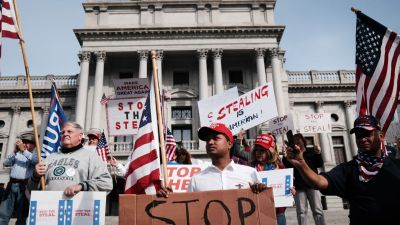 Dozens of people calling for stopping the vote count in Pennsylvania due to alleged fraud against President Donald Trump gather on the steps of the State Capital on November 05, 2020 in Harrisburg, Pennsylvania. (Photo by Spencer Platt/Getty Images)