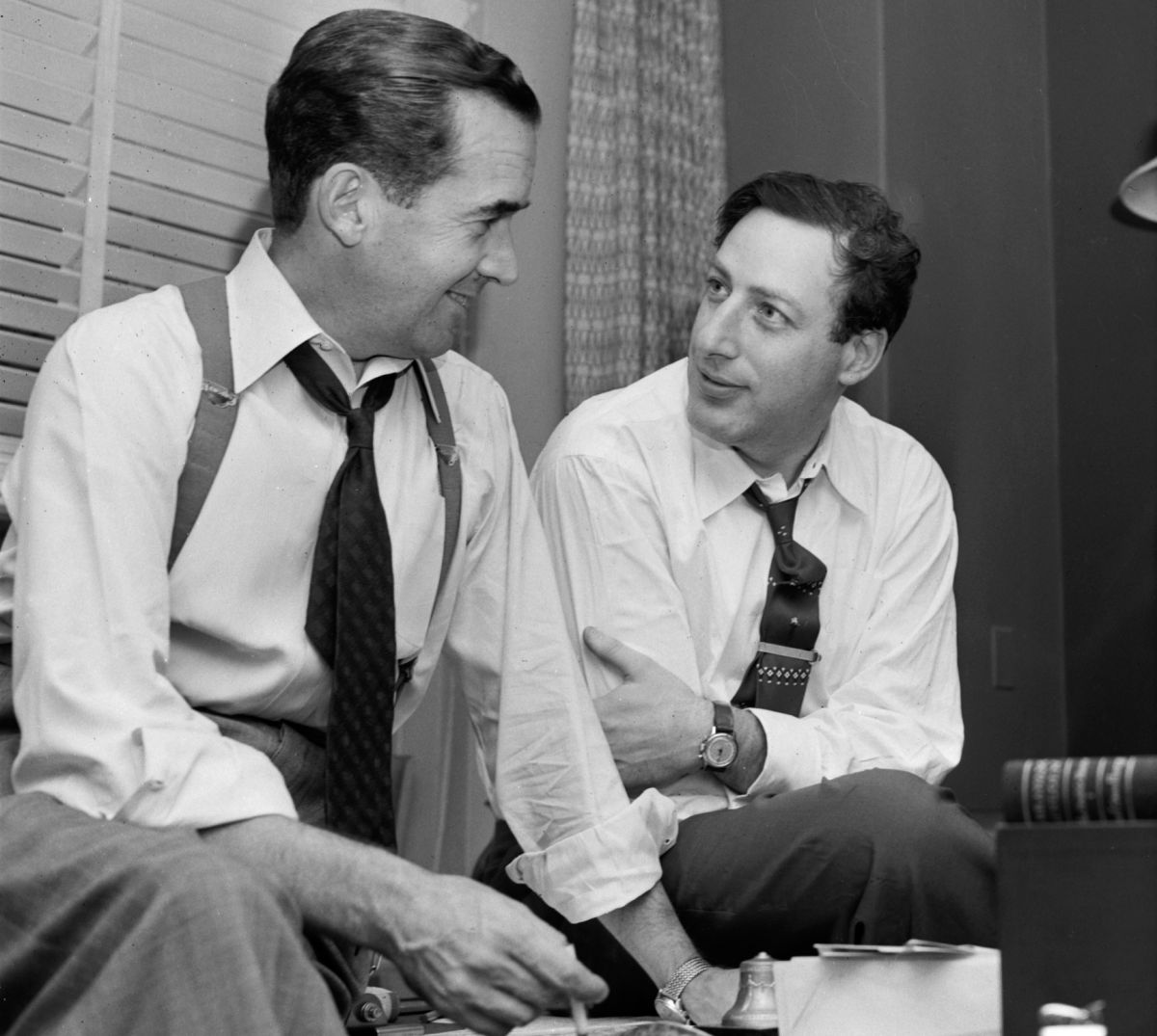 Journalist Edward R. Murrow (left) and producer Fred Friendly, in their CBS office in New York, Oct. 15, 1954. (Photo by CBS Photo Archive/Getty Images)